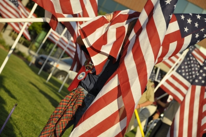 Scout assisiting many other volunteers in setting up a Healing Field for Patriot Day, Sandy, Utah.