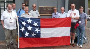A group of vexillologists visit the site of the Marshall House Inn with a replica of the Confederate flag