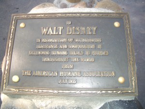 Plaque at the base of Frontierland's flagpole, dedicated to Walt Disney
